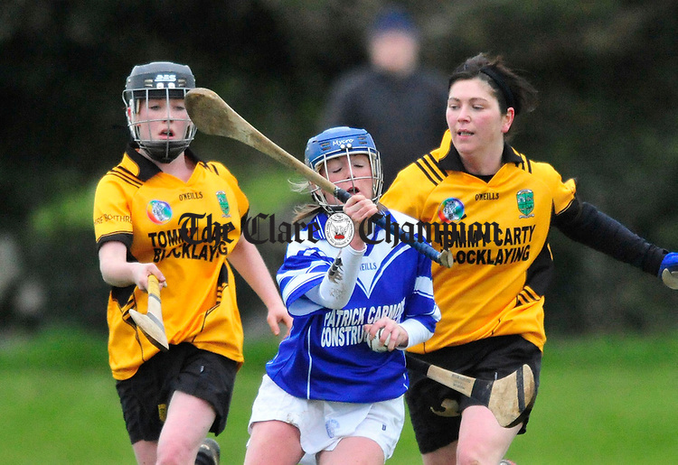 Kilmaley's Helen Mc Mahon under pressure from the Four Roads defence. Photograph by Declan Monaghan