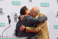 HOLLYWOOD, CA - APRIL 7:  Billy Crystal, Carl Reiner pictured at the Father and Son Hand and Foot Print Ceremony for Carl Reiner and Rob Reiner at the TCL Chinese Theater in Hollywood, California on April 7, 2017. Credit: David Edwards/MediaPunch