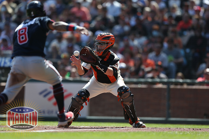SAN FRANCISCO, CA - SEPTEMBER 19:  Buster Posey #28 of the San Francisco Giants tags out Atlanta Braves base runner Eddie Rosario #8 at home plate during the game at Oracle Park on Sunday, September 19, 2021 in San Francisco, California. (Photo by Brad Mangin)