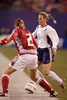 """USA's Kristine Lilly is marked by Mariann Knudsen of Denmark. The US Women's National Team tied the Denmark Women's National Team 1 to 1 during game 8 of the 10 game the """"Fan Celebration Tour"""" at Giant's Stadium, East Rutherford, NJ, on Wednesday, November 3, 2004.."""
