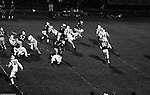 Bethel Park PA:  Offensive play with Mike Stewart 11 running an end sweep that was well defended by Montour. Others in the photo; Clark Miller 30, Chip Huggins 32, Glenn Eisaman 71, Dennis Franks 66, Tom Skladany 86. The offense and defense did not play well in the 12-6 defeat vs Montour. Montour's quarterback, Jim Daniels, killed the Blackhawks.  Jim Daniels was played his college ball at Pitt.  The defensive unit was one of the best in Bethel Park history only allowing a little over 7 points a game.
