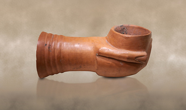 Hittite terra cotta ceremonial libation vessel in the shape of a mug being held in a hand and an arm. Hittite Period, 1600 - 1200 BC.  Hattusa Boğazkale. Çorum Archaeological Museum, Corum, Turkey. Against a warm art bacground.