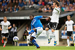 St Johnstone v Rosenborg....25.07.13  Europa League Qualifier<br /> Nigel Hasselbaink and Mike Jensen<br /> Picture by Graeme Hart.<br /> Copyright Perthshire Picture Agency<br /> Tel: 01738 623350  Mobile: 07990 594431