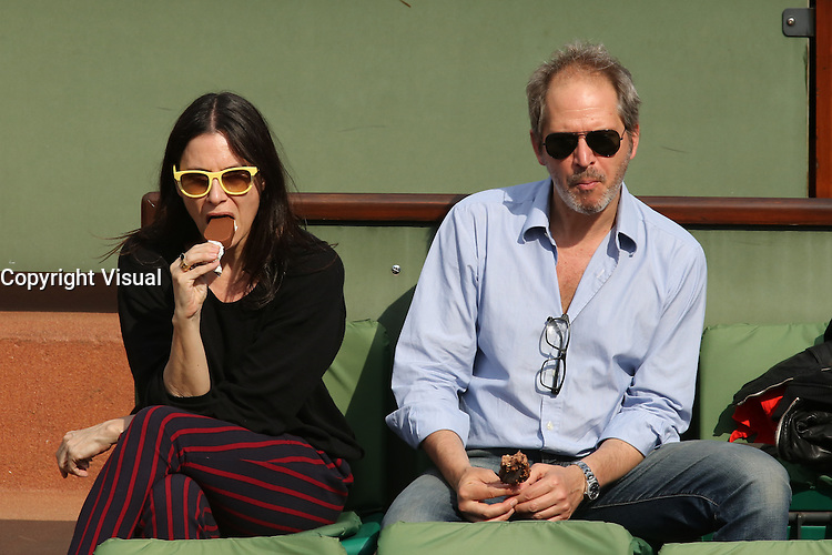Geraldine Pailhas and Christopher Thompson seen watching tennis during Roland Garros tennis open 2016 on may 27 2016.