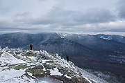 Appalachian Trail - Two hikers explore the summit of Mount Garfield during the winter months in the White Mountains, New Hampshire.