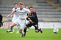 Raith Rovers' Jason Thomson and Caley's Daniel Williams challenge for the ball.