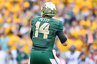 Baylor quarterback Bryce Petty (14) looks downfield to throw during an NCAA football game, Saturday, October 11, 2014 in Waco, Tex. Baylor defeated TCU 61-58 to remain undefeated in BIG 12 conference. (Mo Khursheed/TFV Media via AP Images)