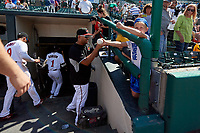 Rochester Red Wings Fernando Romero signs autographs after an International League game against the Scranton/Wilkes-Barre RailRiders on June 25, 2019 at Frontier Field in Rochester, New York.  Rochester defeated Scranton 10-9.  (Mike Janes/Four Seam Images)