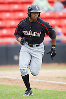 Kyle Colligan #23 of the Kannapolis Intimidators hustles down the first base line against the Hickory Crawdads at  L.P. Frans Stadium August 1, 2010, in Hickory, North Carolina.  Photo by Brian Westerholt / Four Seam Images