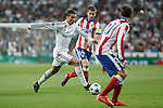 Real Madrid's Cristiano Ronaldo (L) and Atletico del Madrid´s Gabi during quarterfinal second leg Champions League soccer match at Santiago Bernabeu stadium in Madrid, Spain. April 22, 2015. (ALTERPHOTOS/Victor Blanco)