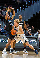 WASHINGTON, DC - JANUARY 28: Mac McClung #2 of Georgetown pushes into Henry Baddley #20 of Butler during a game between Butler and Georgetown at Capital One Arena on January 28, 2020 in Washington, DC.