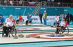 Ina Forrest and Jim Armstrong, Sochi 2014 - Wheelchair Curling // Curling en fauteuil roulant.<br /> Canada competes against USA in Wheelchair Curling round robin play // Le Canada affronte les États-Unis dans le tournoi à la ronde de curling en fauteuil roulant. 10/03/2014.