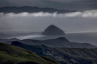 Moro Rock stands out amongst the fog enveloping Moro Bay, California