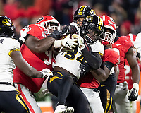 ATHENS, GA - NOVEMBER 09: Larry Rountree III #34 of the Missouri Tigers is tackled by Jordan Davis #99 and Monty Rice #32 of the Georgia Bulldogs during a game between Missouri Tigers and Georgia Bulldogs at Sanford Stadium on November 09, 2019 in Athens, Georgia.