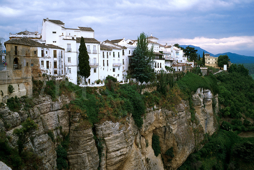Ronda, Spain. Whitehashed homes built on the edge of cliff. Ronda Andalucia Spain.