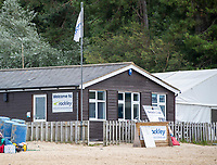 BNPS.co.uk (01202) 558833. <br /> Pic: BNPS<br /> <br /> Pictured: The rockley Watersports Training and activity offices by the beach at Rockley Point in Poole Harbour, Dorset. <br /> <br /> There are fresh calls for a holiday park to increase safety measures at a notorious beach where one swimmer has drowned and almost 20 children rescued this summer. <br /> <br /> In the latest incident a dad and his two young sons were plucked to safety in the nick of time after they were swept away by a rip tide at Rockley Park in Poole Harbour, Dorset.<br /> <br /> It happened a month after hero swimmer Callum Baker-Osborne, 18, drowned while helping to rescue 13 children at the same spot.<br /> <br /> And before that two young girls were saved from drowning by a paddleboarder.