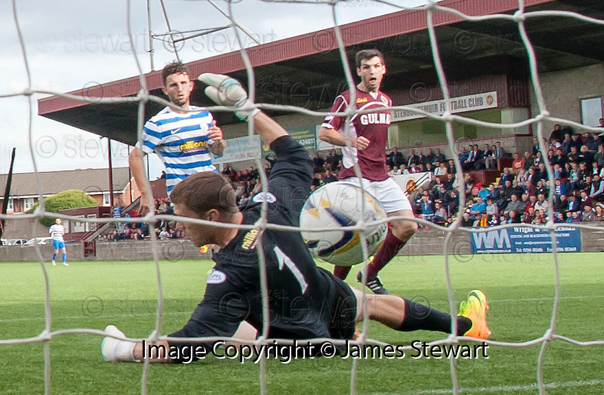 Stenny's Martin Grehan scores their first goal.