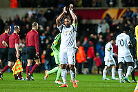 Swansea, UK. Thursday 20 February 2014<br /> Pictured: Ashley Williams applauds the Swansea fans<br /> Re: UEFA Europa League, Swansea City FC v SSC Napoli at the Liberty Stadium, south Wales, UK