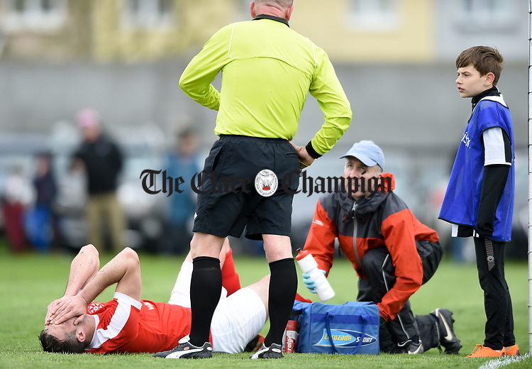 Stephen Kelly of Newmarket Celtic is treated for a leg injury during their Munster Junior Cup semi-final at Limerick. Photograph by John Kelly.