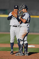 Scranton Wilkes-Barre Yankees catcher Jesus Montero #21 talks with pitcher Eric Wordkemper #39 during a game against the Rochester Red Wings at Frontier Field on April 9, 2011 in Rochester, New York.  Rochester defeated Scranton 7-6 in twelve innings.  Photo By Mike Janes/Four Seam Images