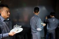 Kitchen workers  at the Ultraviolet restaurant in Shanghai, China on27th Sept 2013.  The restaurant in run by Chef Paul Pairet. <br /> <br /> Photo by Qilai Shen / Sinopix