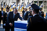Israeli President Reoven Rivlin pay his respects to Former president Shimon Peres's casket placed outside the Knesset Israelis parliament in Jerusalem so that the public may pay its last respects on Thursday Sept 29 2016. Peres 93 passed away Tuesday, he was the last member of Israel's founding generation, and was feted internationally as a visionary man of peace. Photo by Eyal Warshavsky