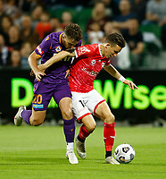 18th April 2021; HBF Park, Perth, Western Australia, Australia; A League Football, Perth Glory versus Wellington Phoenix; Louis Fenton of Wellington Phoenix blocks Carlo Armiento of the Perth Glory from entering the box