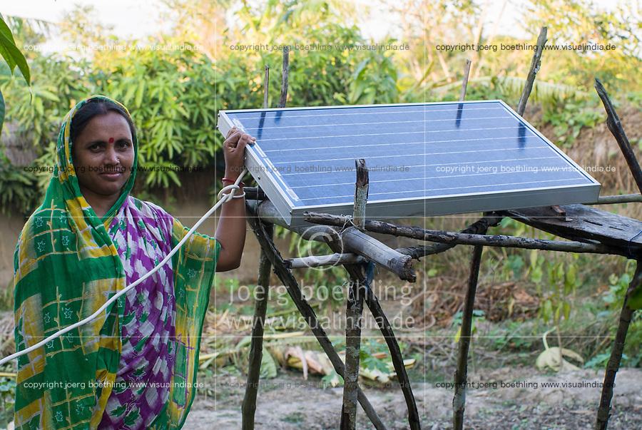BANGLADESH , Sundarbans, village Burigoalinoi , micro-finance bank Grameen Shakti and NGO Srizony , promote micro-credit financed Solar Home Systems in villages, woman with PV panel