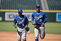 Kansas City Royals outfielders Rudy Martin (9) and Khalil Lee (15) jog off the field between innings of an Instructional League game against the Arizona Diamondbacks at Chase Field on October 14, 2017 in Scottsdale, Arizona. (Zachary Lucy/Four Seam Images)