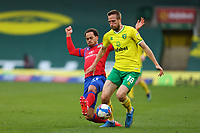 20th March 2021; Carrow Road, Norwich, Norfolk, England, English Football League Championship Football, Norwich versus Blackburn Rovers; Elliott Bennett of Blackburn Rovers challenges Marco Stiepermann of Norwich City