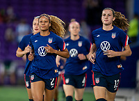 ORLANDO, FL - FEBRUARY 24: Casey Krueger #2 and Tierna Davidson #12 of the USWNT enter the field before a game between Argentina and USWNT at Exploria Stadium on February 24, 2021 in Orlando, Florida.