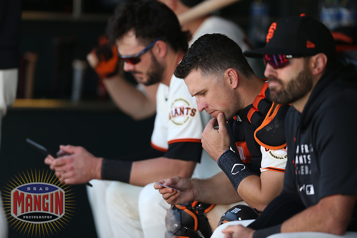 SAN FRANCISCO, CA - AUGUST 1:  Buster Posey #28 of the San Francisco Giants sits in the dugout during the game against the Houston Astros at Oracle Park on Sunday, August 1, 2021 in San Francisco, California. (Photo by Brad Mangin)
