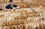 Foto: VidiPhoto<br /> <br /> WOLFHEZE - Tim van der Weijde grasveredelaar bij Barenbrug, op de proeflocatie in Wolfheze. Barenbrug werkt aan een supergras dat minder stikstof nodig heeft om snel te kunnen groeien en beter tegen droogte kan. Op de locatie in Wolheze hangen duizenden zakken met proefgewassen te drogen. Droogtetolerantie wordt getest onder zogenoemde rainout shelters, plastic kappen die via rails verplaatst kunnen worden.