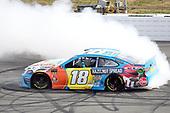 #18: Kyle Busch, Joe Gibbs Racing, Toyota Camry M&M's Hazelnut, does a burnout after winning