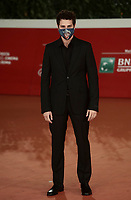 "Italian actor Andrea Arcangeli wearing a face mask poses on the red carpet for the screening of the film ""Romulus"" during the 15th Rome Film Festival (Festa del Cinema di Roma) at the Auditorium Parco della Musica in Rome on October 24, 2020.<br />