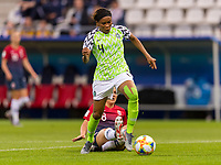 REIMS, FRANCE - JUNE 08: Ngozi Ebere #4 avoids the tackle of Vilde Bo Risa #8 during a game between Norway and Nigeria at Stade Auguste-Delaune on June 8, 2019 in Reims, France.