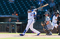 Surprise Saguaros designated hitter Vladimir Guerrero Jr. (27), of the Toronto Blue Jays organization, follows through on his swing in front of catcher Joe DeCarlo (4) and home plate umpire Brennan Miller during an Arizona Fall League game against the Peoria Javelinas at Surprise Stadium on October 17, 2018 in Surprise, Arizona. (Zachary Lucy/Four Seam Images)