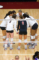 STANFORD, CA - DECEMBER 5:  Alix Klineman of the Stanford Cardinal huddles with Janet Okogbaa, Cynthia Barboza, Cassidy Lichtman, Gabi Ailes, Foluke Akinradewo, and Erin Waller during Stanford's 3-0 win over Albany in the NCAA Division 1 Women's Volleyball first round on December 5, 2008 at Maples Pavilion in Stanford, California.