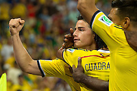 James Rodriguez of Columbia celebrates scoring a goal after making it 2-0