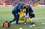 Aberdeen v St Johnstone…31.03.18…  Pittodrie    SPFL<br />An injured Blair Alston is helped up by physio Mel Stewart and club doctor<br />Picture by Graeme Hart. <br />Copyright Perthshire Picture Agency<br />Tel: 01738 623350  Mobile: 07990 594431