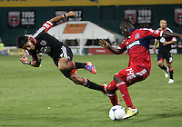 WASHINGTON, DC. - AUGUST 22, 2012:  Andy Najar (14) of DC United trips going for the ball with  Patrick Nyarko (14) of the Chicago Fire during an MLS match at RFK Stadium, in Washington DC,  on August 22. United won 4-2.