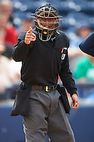 Umpire Richard Genera makes a call during a game between the Cedar Rapids Kernels and West Michigan Whitecaps on June 7, 2015 at Fifth Third Ballpark in Comstock Park, Michigan.  West Michigan defeated Cedar Rapids 6-2.  (Mike Janes/Four Seam Images)