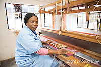 Africa, Swaziland, Malkerns.Nest organization artisan project, partnering with Rosecraft weaving  & local artisans to help market their products to global markets and better sustain their local community. Woman working at the large looms.
