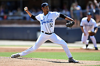 Asheville Tourists starting pitcher Eris Filpo (32) delivers a pitch during a game against the Charleston RiverDogs at McCormick Field on August 18, 2019 in Asheville, North Carolina. The Tourists defeated the RiverDogs 6-5. (Tony Farlow/Four Seam Images)