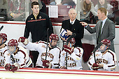 Quinn Smith (BC - 27), Kevin Pratt (BC - Student Manager), Kevin Hayes (BC - 12), Jerry York (BC - Head Coach), Austin Cangelosi (BC - 26), Greg Brown (BC - Associate Head Coach), Ryan Fitzgerald (BC - 19) - The Boston College Eagles defeated the visiting University of Wisconsin Badgers 9-2 on Friday, October 18, 2013, at Kelley Rink in Conte Forum in Chestnut Hill, Massachusetts.