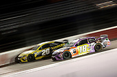 DARLINGTON, SOUTH CAROLINA - MAY 20: Erik Jones, driver of the #20 STANLEY Toyota, leads Kyle Busch, driver of the #18 M&M's Fudge Brownie Toyota, during the NASCAR Cup Series Toyota 500 at Darlington Raceway on May 20, 2020 in Darlington, South Carolina. (Photo by Chris Graythen/Getty Images)