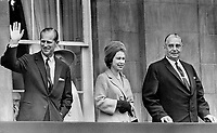 Visite de la Reine Elizabeth II , Octobre 1964, <br /> <br /> <br /> A Princely gesture is made by the Duke of Edinburgh as he and the Queen take in the view from Charlottetown's Provincial House with Premier and Mrs. Walter Shaw. After they had signed the golden book in Confederation Chamber; the Prince flipped back through the pages and found the signatures they signed when they first visited here in 1951-as a young prince and the princess he had just married. The Queen is now 38 and the Duke is 43.<br /> <br /> 1964<br /> <br /> PHOTO :  Frank Grant - Toronto Star Archives - AQP