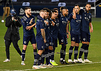 KANSAS CITY, KS - NOVEMBER 22: Sporting KC watch the penalty kick shoot out from midfield before a game between San Jose Earthquakes and Sporting Kansas City at Children's Mercy Park on November 22, 2020 in Kansas City, Kansas.