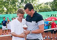 August 9, 2014, Netherlands, Rotterdam, TV Victoria, Tennis, National Junior Championships, NJK, Prize giving, Wimbledon winner Richard Krajicek gives the prize for the winner boys 14 years to his son Alec Deckers <br /> Photo: Tennisimages/Henk Koster