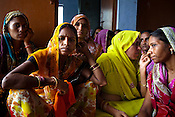 Anganwadi workers from different villagers gather to discuss agenda and programmes in the Government Block office in Moth town in Uttar Pradesh, India. The Indian government spends $1.4 billion a year - on programs that include weighing newborn babies, counseling mothers on healthy eating and supplementing meals, but none of this is yeilding results. According to UNICEF, some 48% of Indian children, or 61 million kids, remain malnourished, the clinical condition of being so undernourished that their physical and mental growth are stunted. Photo: Sanjit Das/Panos for The Wall Street Journal.Slug: IMALNUT
